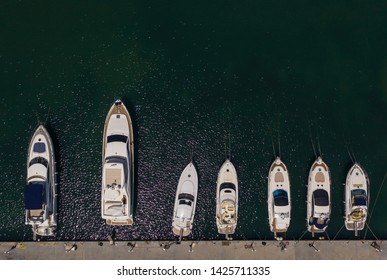Aerial view from drone to yacht and sailboat is moored at the quay
