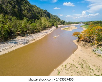 Aerial view of dry river of Kok river in hot season nearly Chiang Rai beach, a river bank with rocky shores view.