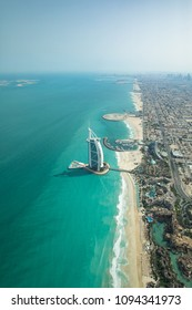 Aerial view of Dubai city beach and coast line on a clear sunny day.