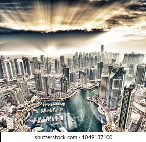 Aerial view of Dubai Marina buildings at dusk.