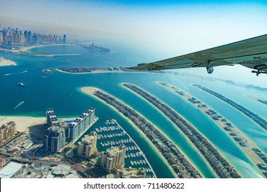 Aerial view of Dubai palm island from water plane