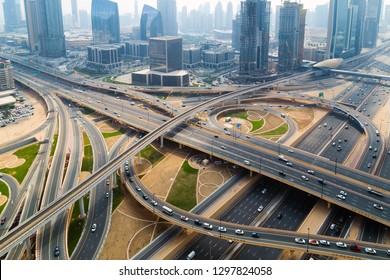 Aerial view Dubai skyline bridge of highway traffic city. Transport traffic uae road with vehicle movement aerial view. Top view. Background scenic road.
