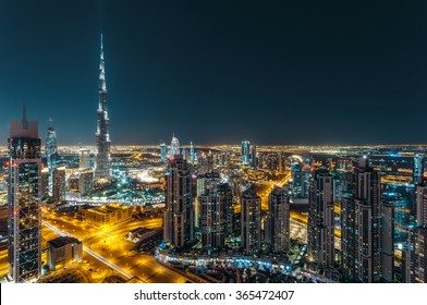 Aerial view of Dubai's business bay architecture by night.