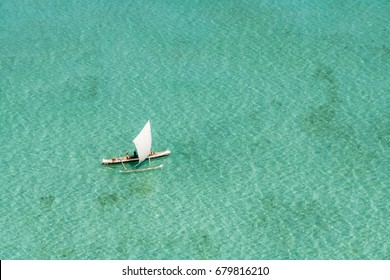 Aerial view of a dugout canoe in the lagoon of Salary, Madagascar