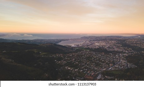 Aerial view of Dunedin city at sunrise   from sky.