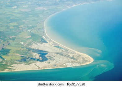 Aerial view of Dungeness headland jutting into the English Channel at Kent, England.  Towards the bottom is the Dungeness nuclear power station and to the left is London Ashford Airport.