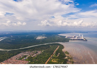 An aerial view during low tide of the shoreline of Sepang near the Avani Sepang Goldcoast Resort. Jimah Power Plant at the coast of Malaysia. The polluted west coast in the strait of Malacca.