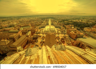 Aerial view at dusk time from the cupola of Papal Basilica over St. Peter's Square in the Vatican City. Rome, Italy.