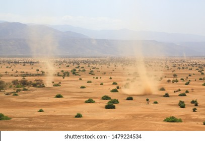 Aerial view of dust devils in Shompole conservancy area in the Great Rift Valley, near Lake Magadi, Kenya. The Rift Valley has many volcanoes and lakes such as the Turkana, Nakuru and Natron.