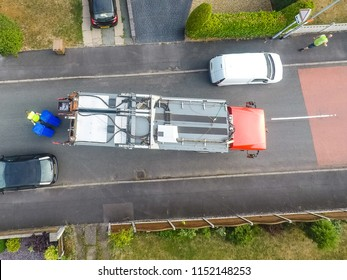 Aerial View of Dustmen putting recycling waste into a waste truck, Bin Men, Recycling day, view 3 (All branding, personal info removed or blurred, no intellectual content)