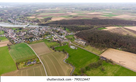 Aerial view of the Dutch Belgian border with the village of Kanne, river Jeker and mountain Cannerberg. In the front an old chateau or castle. It is in the province of Limburg, in the Maastricht area.