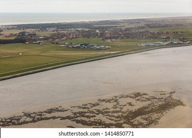 Aerial view Dutch island Ameland with sand bank, houses and villages