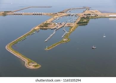 Aerial view Dutch sluices of Kornwerderzand, separation between the fresh water lake IJsselmeer and the salt Wadden Sea