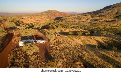 Aerial view in the early morning of caravan and four wheel drive vehicle at free camp in the Karijini National Park, Western Australia.