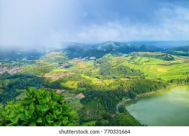 Aerial view of eastern side of Furnas Lagoon (Portuguese: Lagoa das Furnas), located on Azorean island of Sao Miguel in Atlantic Ocean. Slightly fogged skyline.