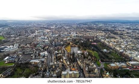 Aerial View of Edinburgh City Town Center feat. Iconic Scottish Landmarks such as Edinburgh Castle, National Museum, The University of Edinburgh, Rail Station Cityscape in Scotland UK