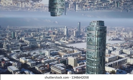 Aerial view of the Ekaterinburg city center with Vysotsky skyscraper, mirror horizon effect. Beautiful landscape of glass facade tall building in Russia, inception theme.