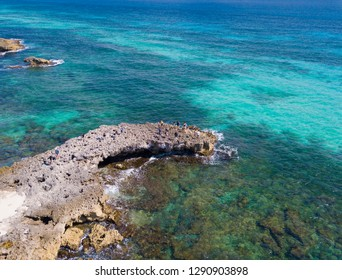 Aerial view of El Mirador with tourists on the coast of Cozumel, Mexico.