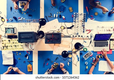 Aerial view of electronics technicians team working