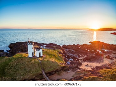 Aerial view of Elie Ness Lighthouse at sunset on the coast of The Kingdom of Fife. Scotland, UK