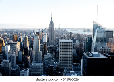Aerial view of the Empire State Building and downtown Manhattan on a clear day at dusk, New York City.