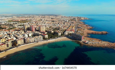 Aerial view empty Los Locos beach during quarantine. Public places closed caused by pandemic disease situation. Quarantine globally spread infection. Stop COVID-19. Torrevieja, Costa Blanca, Spain