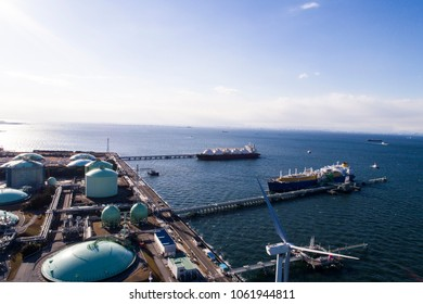 Aerial view of energy facilities and ship.