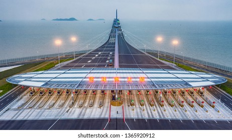 """Aerial View Of The Entrance of Hong Kong-Zhuhai-Macao Bridge.  The Chinese words  means """"Hong Kong-Zhuhai-Macao Bridge""""."""