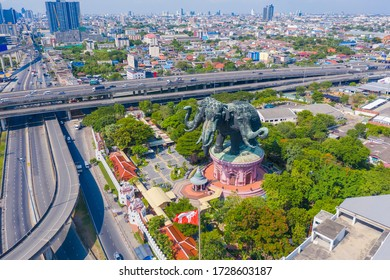 Aerial view of Erawan Museum is a Elephant head sculpture with 3 heads. Tourist attraction of Samut Prakan district with Downtown Bangkok. Urban city at noon, Thailand. Thai landmark architecture.