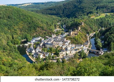 Aerial view of Esch-sur-Sure medieval town in Luxembourg  famous for its ancient  Castle. Forests of Upper-Sure Nature Park, meander of winding river Sauer, near Upper Sauer Lake. Canton Wiltz.