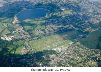 Aerial view of Esher in Surrey with the Sandown Park race course in full view plus the Island Barn Reservoir and the River Mole.  Sunny summer day.