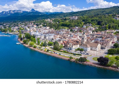 Aerial view of Evian (Evian-Les-Bains) city in Haute-Savoie in France - Shutterstock ID 1780882214