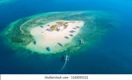 Aerial view of exotic Gili Kedis island with turquoise water in Lombok, Indonesia