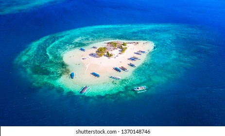 Aerial view of exotic Gili Kedis island with white sand and turquoise water in Bali, Indonesia