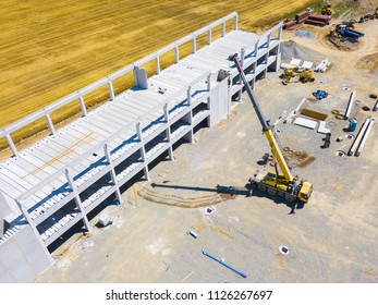 Aerial view of factory construction site. Building up large manufacturing plant in industrial zone on suburb of Dobrany city, Czech Republic, Europe.