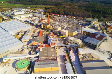 Aerial view of factory plant producing ceramic tiles from raw kaolin material. Top view of industrial area.