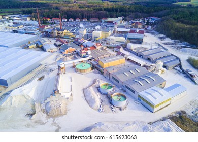 Aerial view of factory plant producing ceramic tiles from raw kaolin material. Top view of large industrial area.