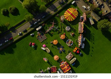 An aerial view of a fairground and circus in a field