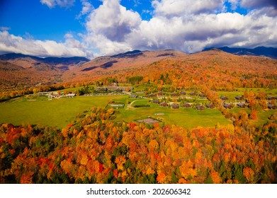 Aerial view of fall foliage including Trapp Family Lodge, Stowe, Vermont, USA