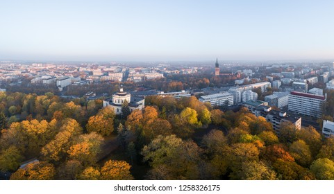 Aerial view of fall foliage on Vartiovuori hill with Turku Cathedral (Finnish: Turun Tuomiokirkko) on background in Turku, Finland