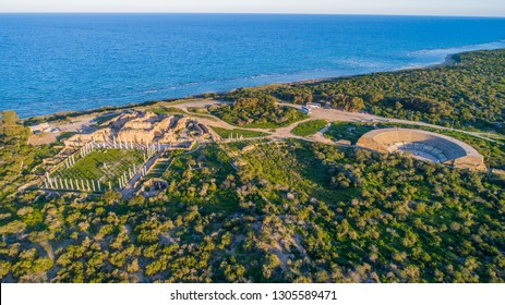 Aerial view of Famagusta ruins in Salamis (Salamis Harabeleri), Northern Cyprus. Ruins and amphitheater of ancient Salamis city before rain on a coast of Mediterranean Sea on Cyprus island