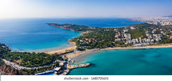 Aerial view to the famous Astir Beach and Vouliagmeni beach at the south coast ov the Athens Riviera with turquoise sea and blue sky, Greece