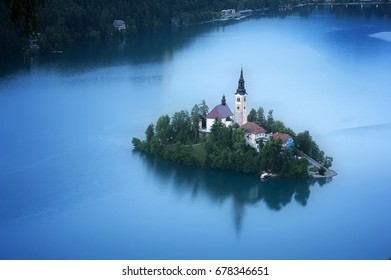 Aerial View of Famous Bled Lake National Park at dusk, on Bled Lake, Slovenia