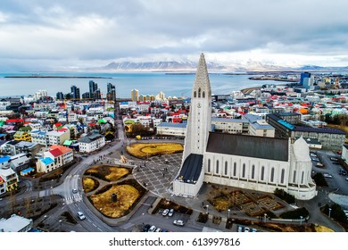 Aerial view of famous Hallgrimskirkja Cathedral and the city of Reykjavik in Iceland. Image taken with action drone camera