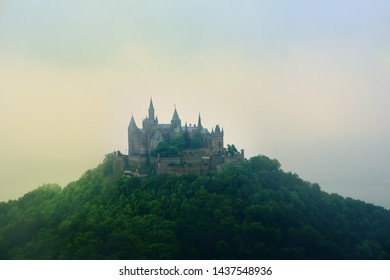 Aerial view of famous Hohenzollern Castle at foggy spring or summer day. Hohenzollern Castle one of Europe's most visited castles.