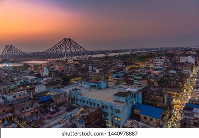 Aerial View of Famous Howrah bridge/ Rabindra Setu along with Burrabazar/ Barabazar area at the time of Blue hour.