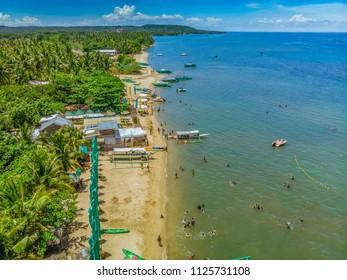 Aerial view of the famous Laiya beach on a peak summer season