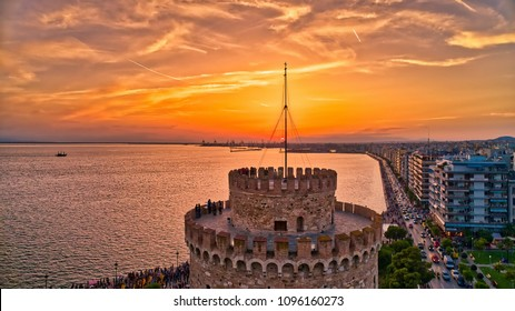 Aerial view of famous White Tower of Thessaloniki at sunset, Greece. Image taken with action drone camera. HDR image