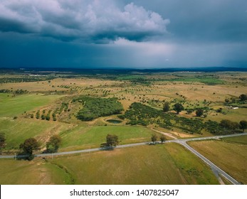 Aerial view of a farm field with storm clouds in background. Alentejo Portugal