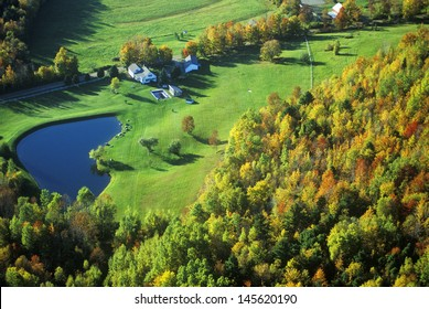 Aerial view of farm with pond near Stowe, VT in autumn on Scenic Route 100